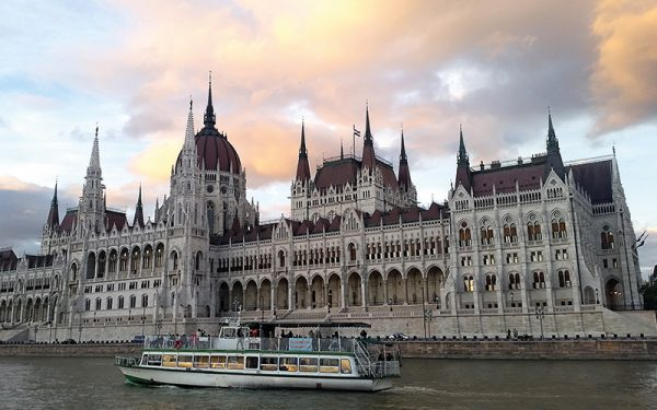 Budapest river with a boat cruising on it