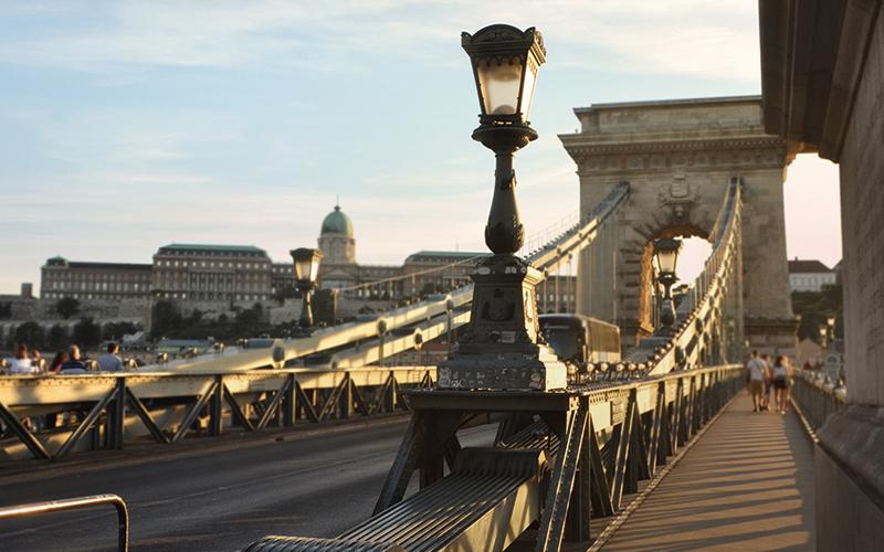 People walking across bridge in Budapest