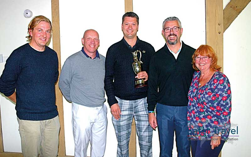 Richard Stuttle and others posing with golf trophy