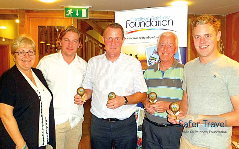 Richard Stuttle, Marjorie Marks-Stuttle and others with golf trophies