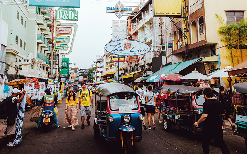 People walking along busy street in Thailand