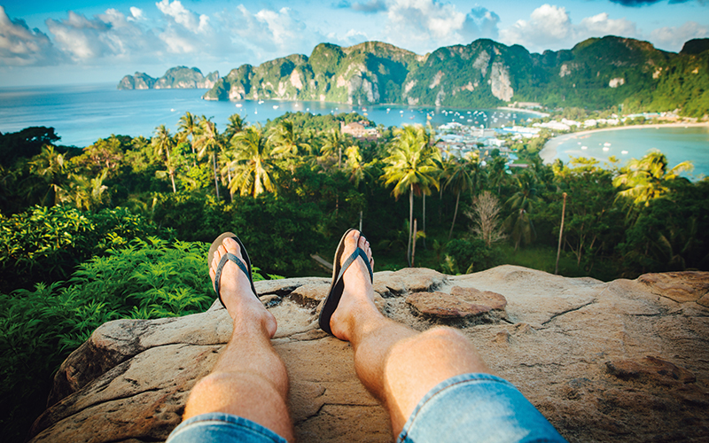 Man relaxing on a rock