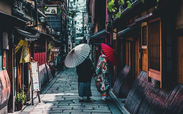 People walking down quiet Japan street