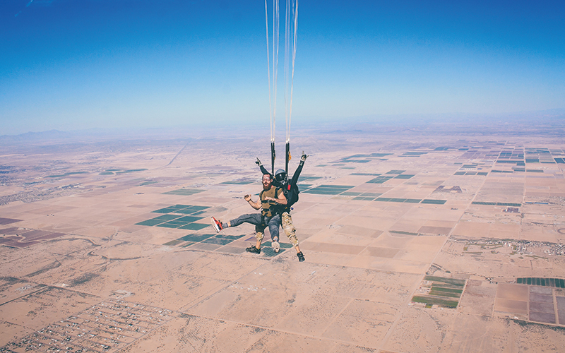 Two people posing during skydiving