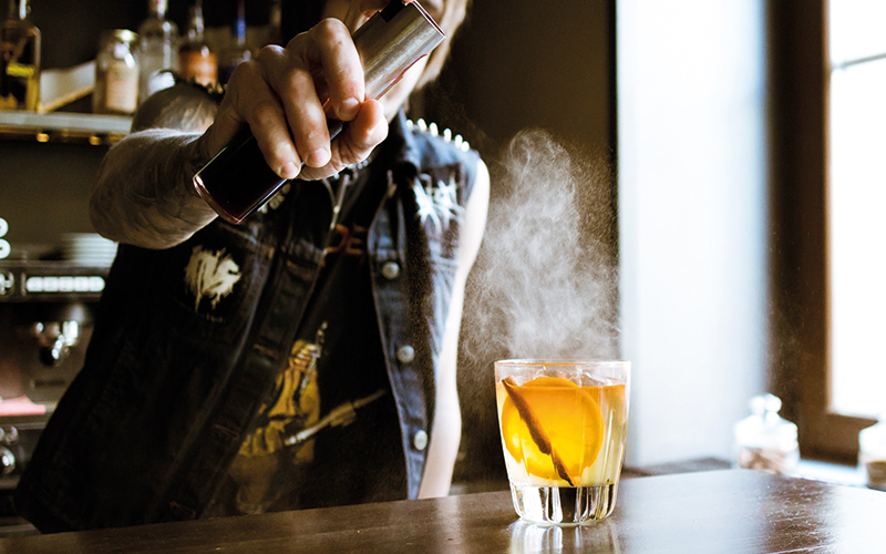 Making a cocktail at the bar