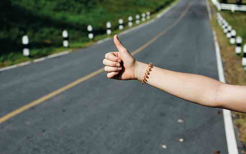 Thumbs up on road
