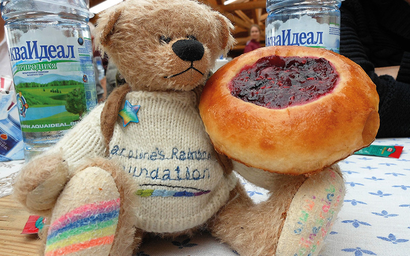 Rainbow Bear with cake and drinks