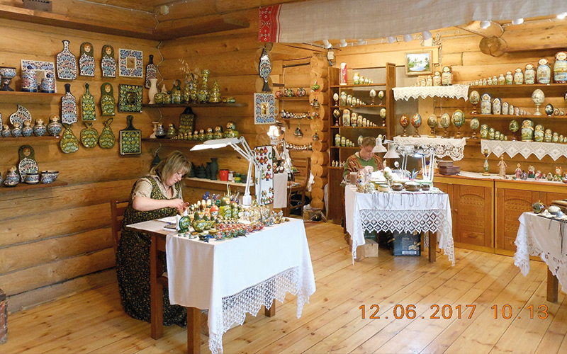 Woman sat making something in shop
