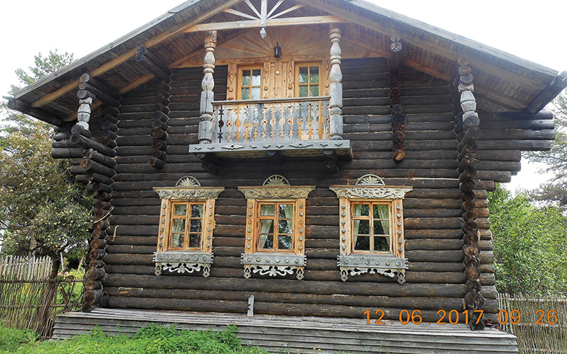 Log cabins with fancy windows