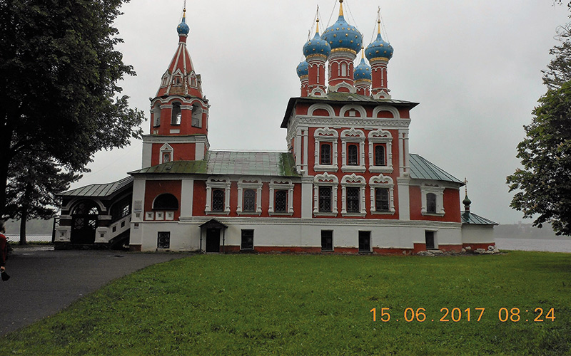 Red and white building with blue and white spires