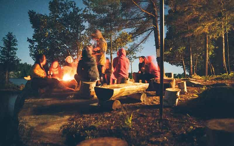 People sat around a campfire