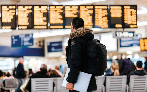 Man looking at train times