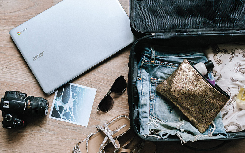 Packing laptop and camera in suitcase