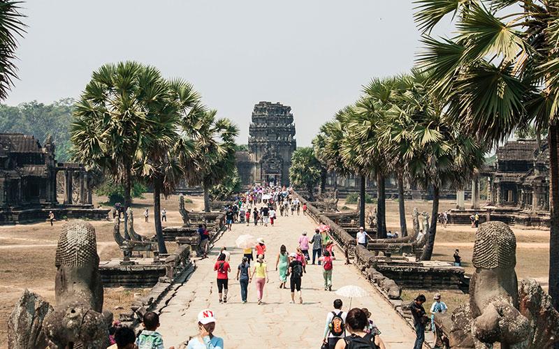 People walking down path in Asia