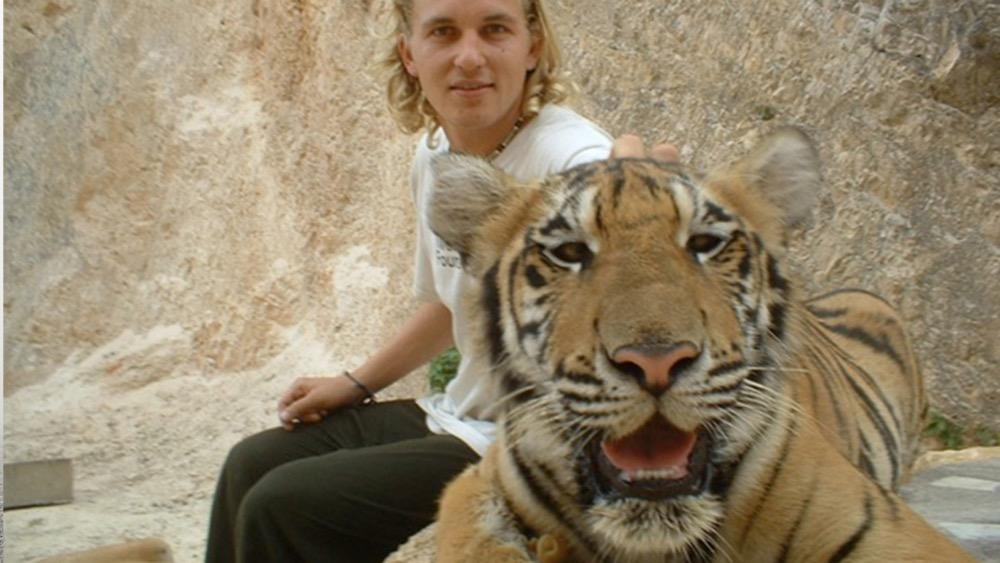 Richard petting a tiger
