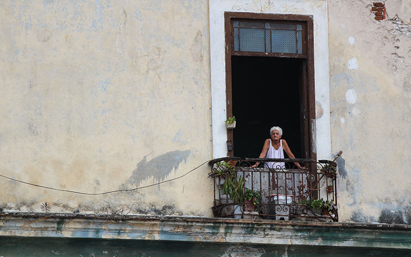 Old woman looking out of window