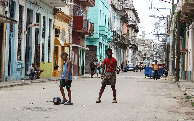 Children playing football in street