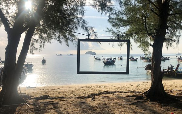 Photo frame with boats by the beach