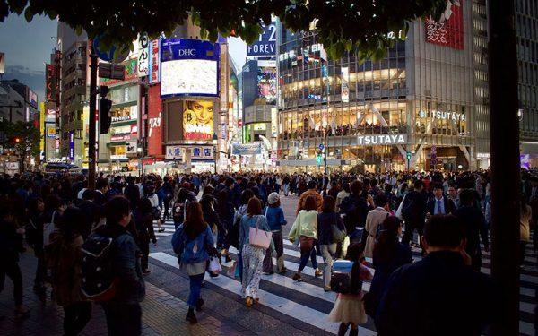 People crossing very busy street