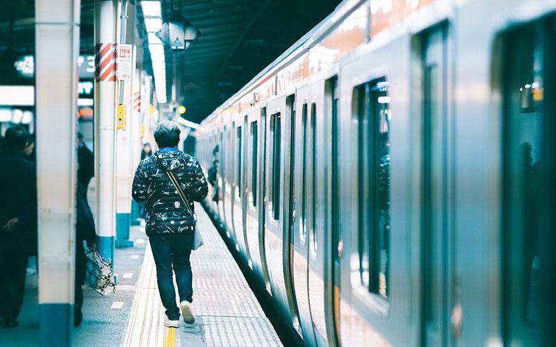 Man walking past train