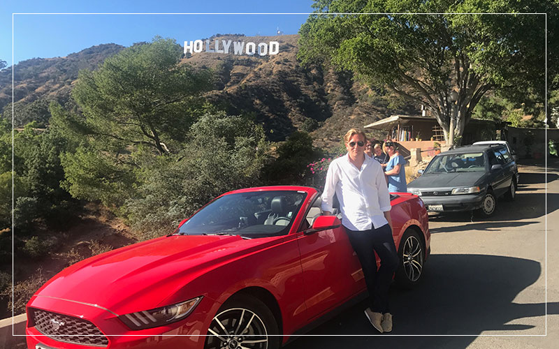Richard Stuttle with a Ford Mustang in California