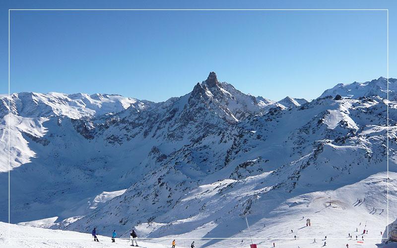 Snowboarders going down Meribel slopes