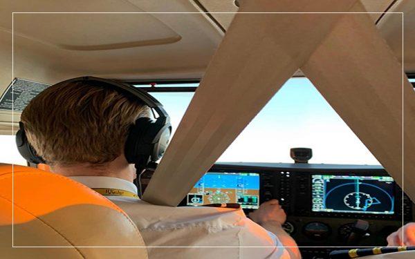 Pilot in cockpit of plane
