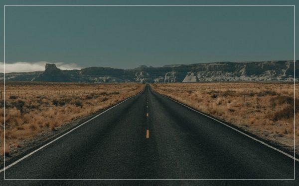 Empty road dark skies