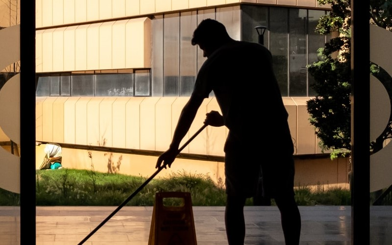 Man cleaning hotel lobby