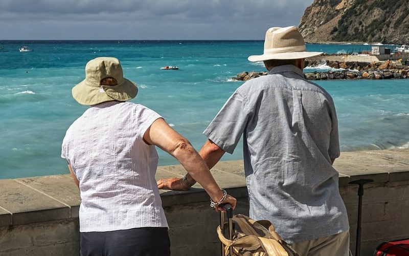 Older couple looking at the sea