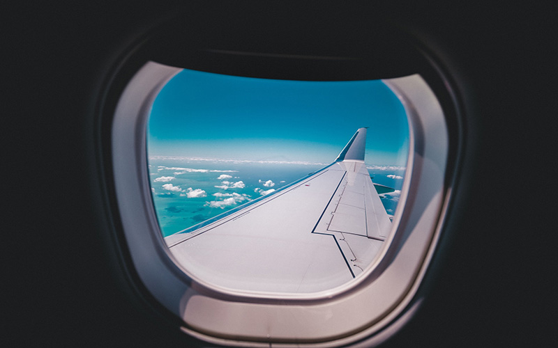 Looking out the window of a plane midair