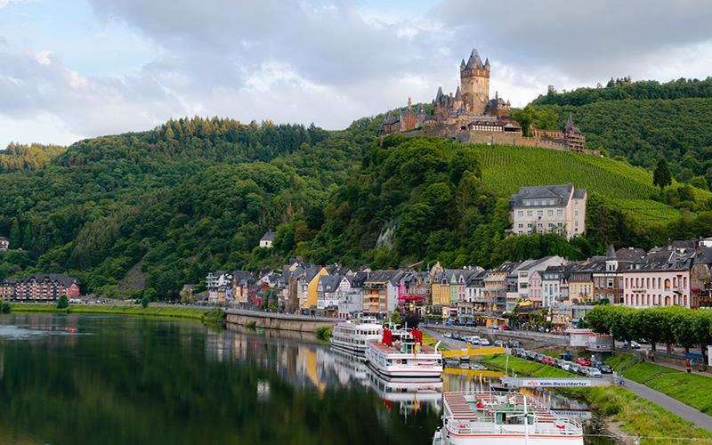 German village and castle overlooking lake