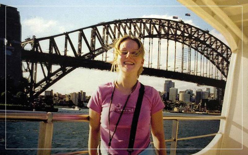 Caroline Stuttle smiling in front of a bridge