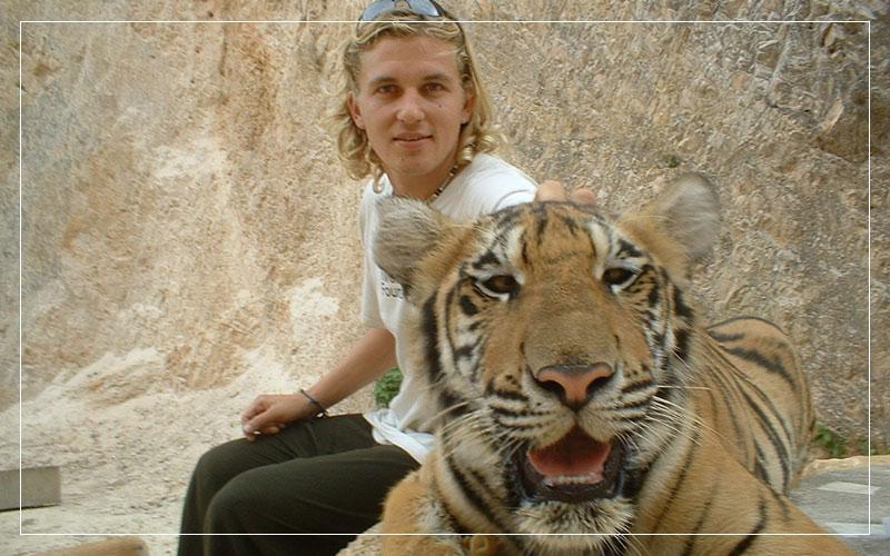 Richard Stuttle petting a tiger