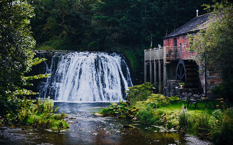 UK holiday cottage with waterfall next to it