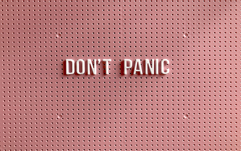 don't panic text pink background