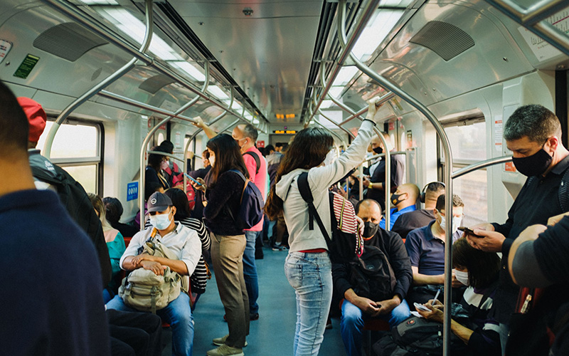 A busy train with lots of people